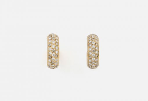 """Pair of """"Fancy"""" earrings in yellow gold with brown diamonds and white diamonds."""