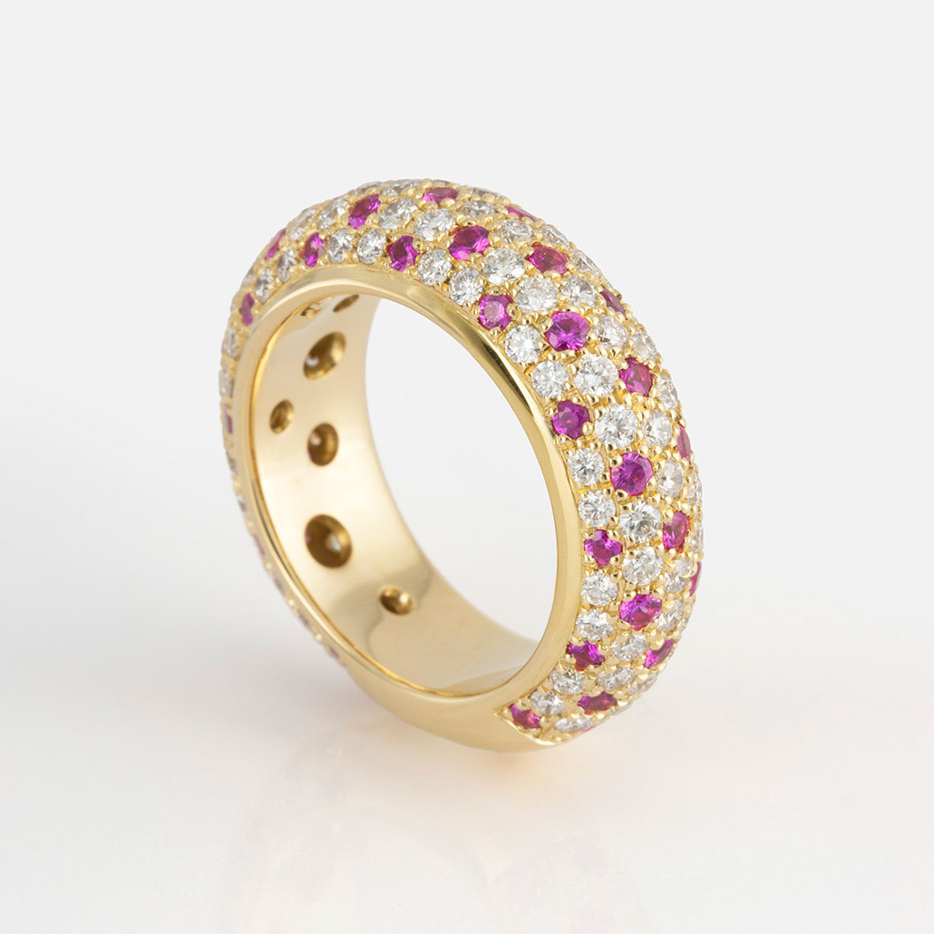 """Fancy"" ring  in gold with diamonds and rose sapphires."