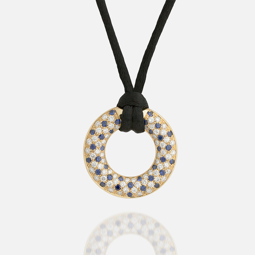 """Fancy"" pendant in yellow gold with blue sapphires and diamonds."