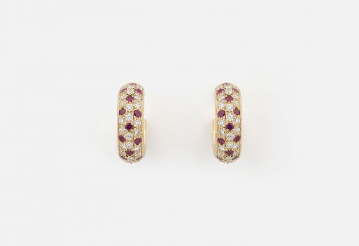 "Pair of ""Fancy"" earrings in yellow gold with rubies and diamonds."