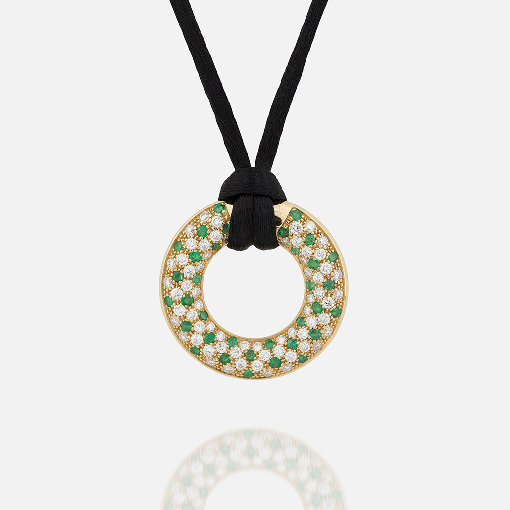"""Fancy"" pendant in yellow gold with emerals and diamonds."