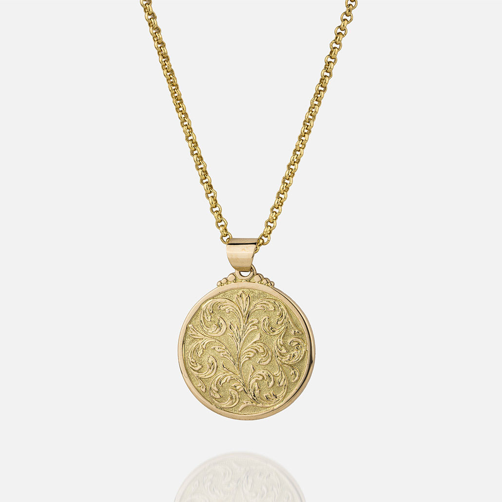 """Large """"Florão"""" cordon and medallion in yellow gold."""