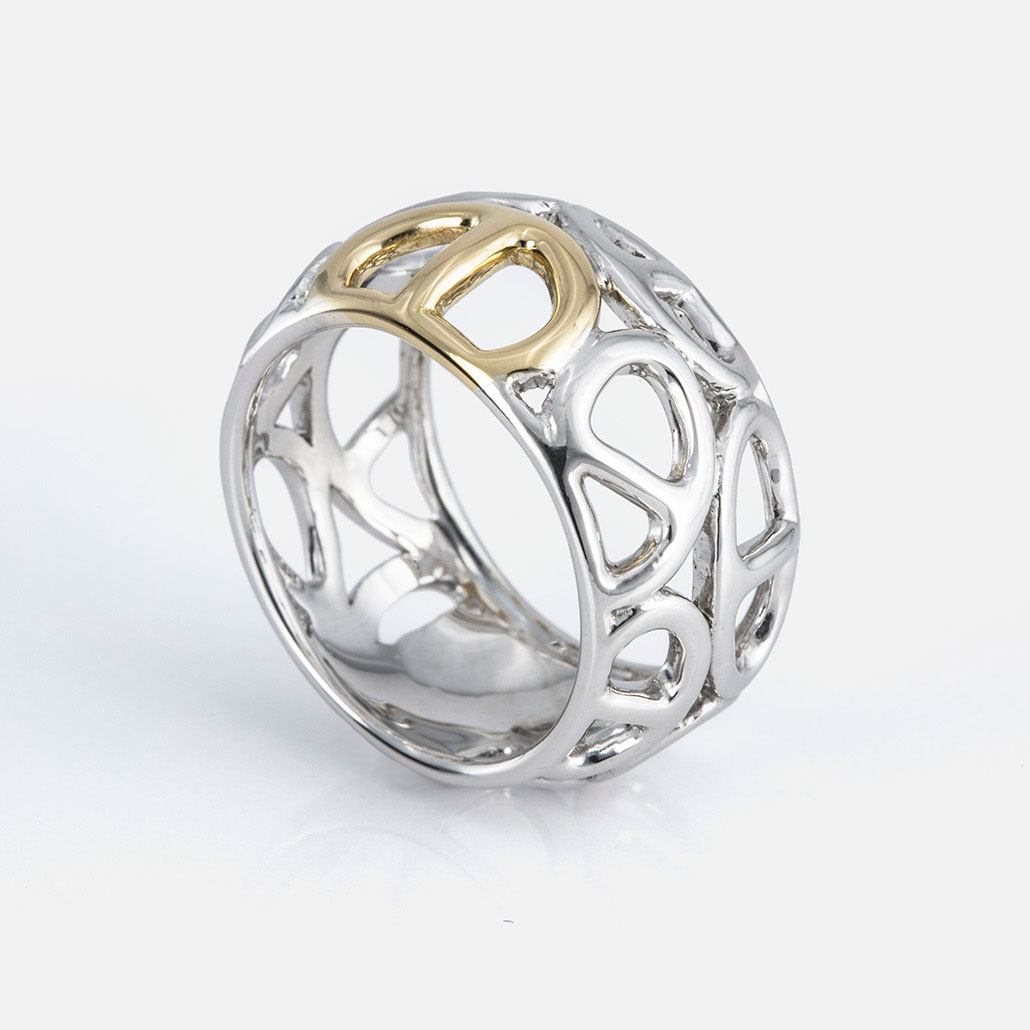 """Elo Náutico"" ring in yellow gold and silver."