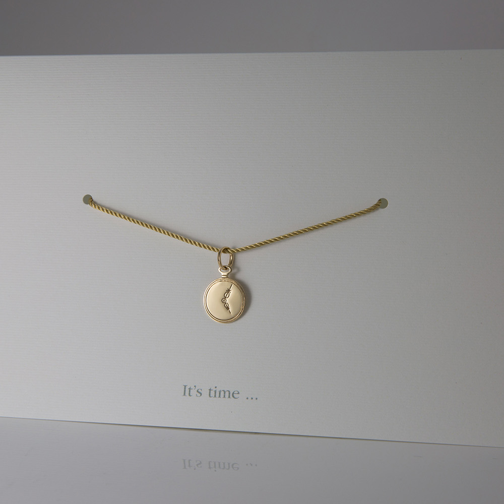"""""""It's Time"""" pendant in yellow gold."""
