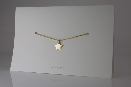 """""""Be a Star"""" pendant in yellow gold."""