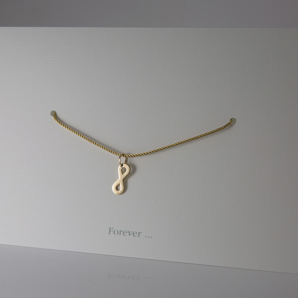 """""""Forever"""" pendant in yellow gold."""