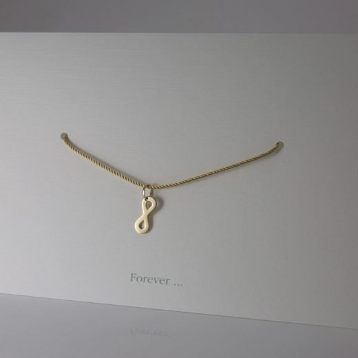 'Forever' pendant in yellow gold