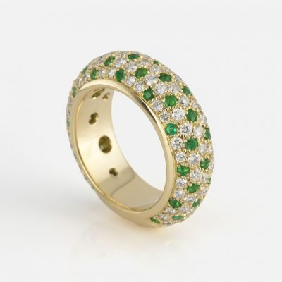'Fancy' ring in yellow gold with emearalds and diamonds
