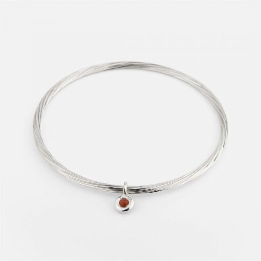 Twisted bracelet in silver with coral trinket