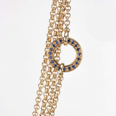 """""""Inverso"""" reversible necklace in gold with diamonds and blue saphires"""