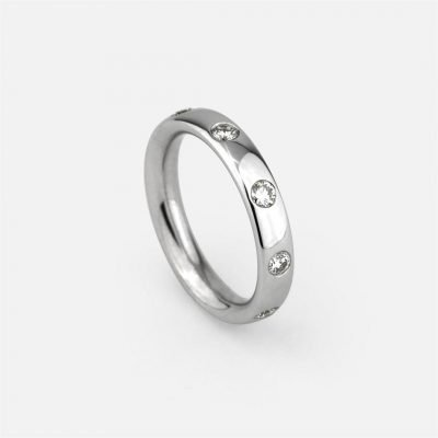 White gold wedding band with 9 diamonds